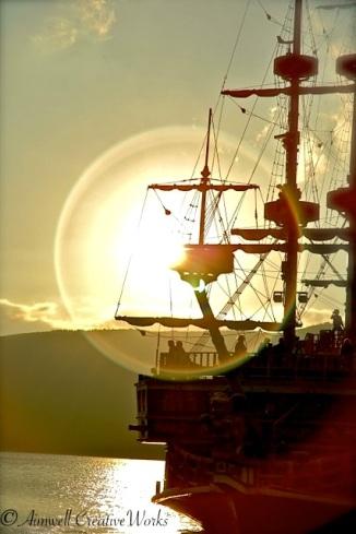 Ship crossing at sunset ... Lake Ashi, Japan