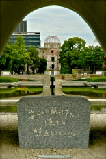 Memorial cenotaph to the atomic bomb victims looking through to Atomic Dome